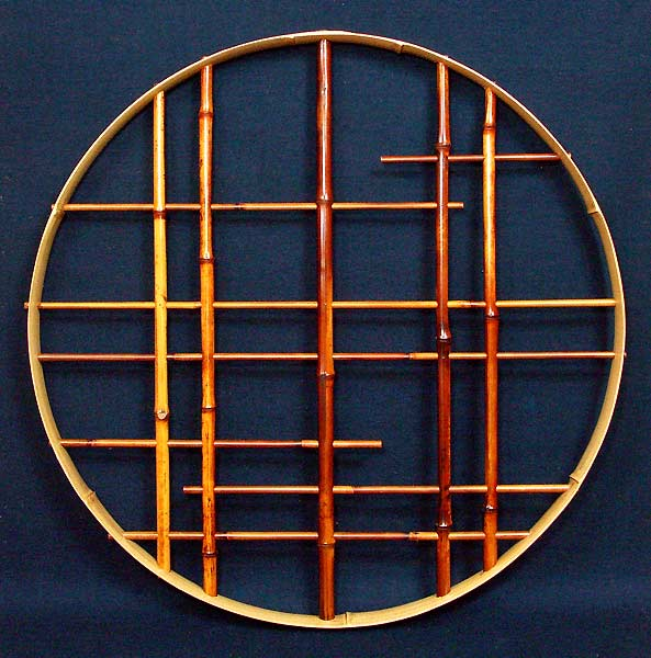Materials Window frame - rust bamboo outer frame - soot bamboo lattice